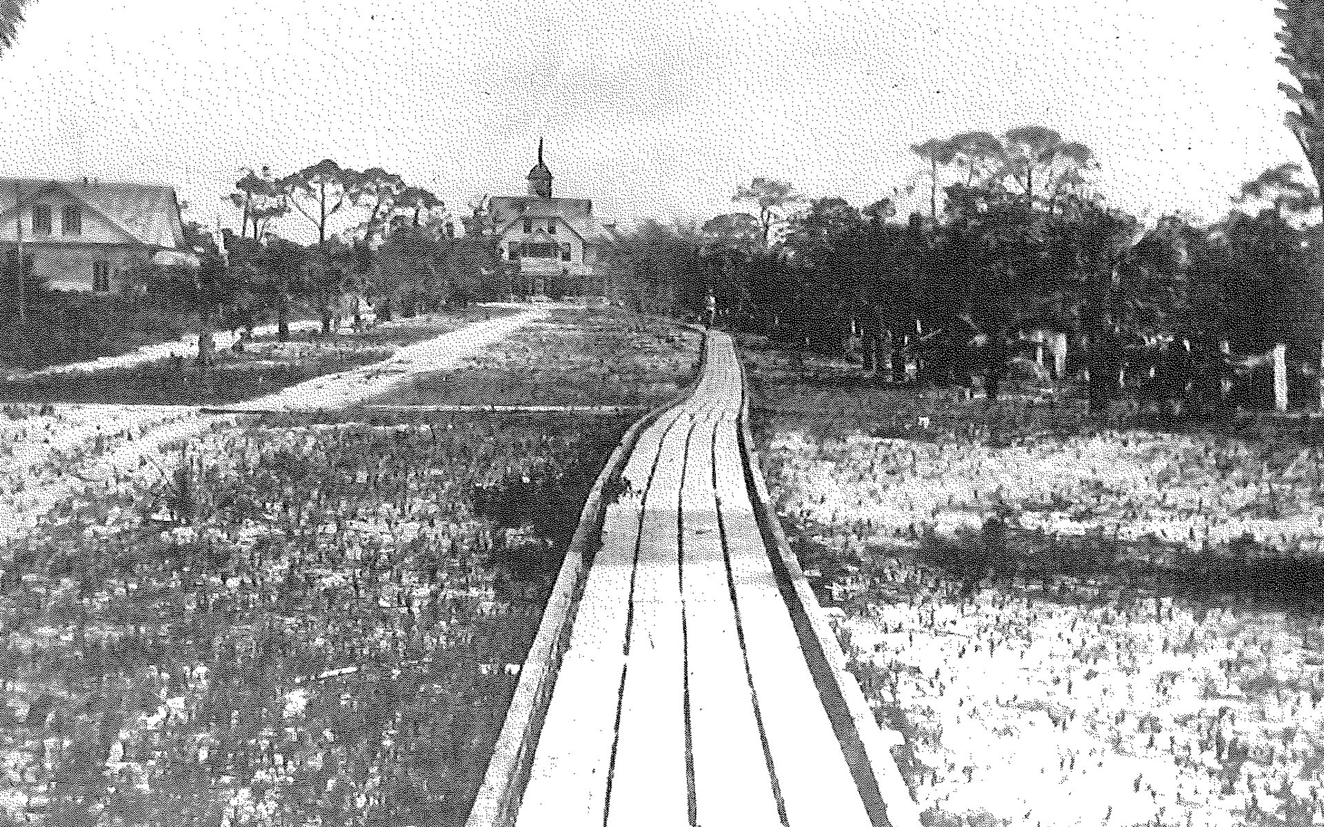 The Old Naples Hotel from the west showing the pathway over which people, luggage and supplies came to and went from the Naples Pier. Circa 1920's.