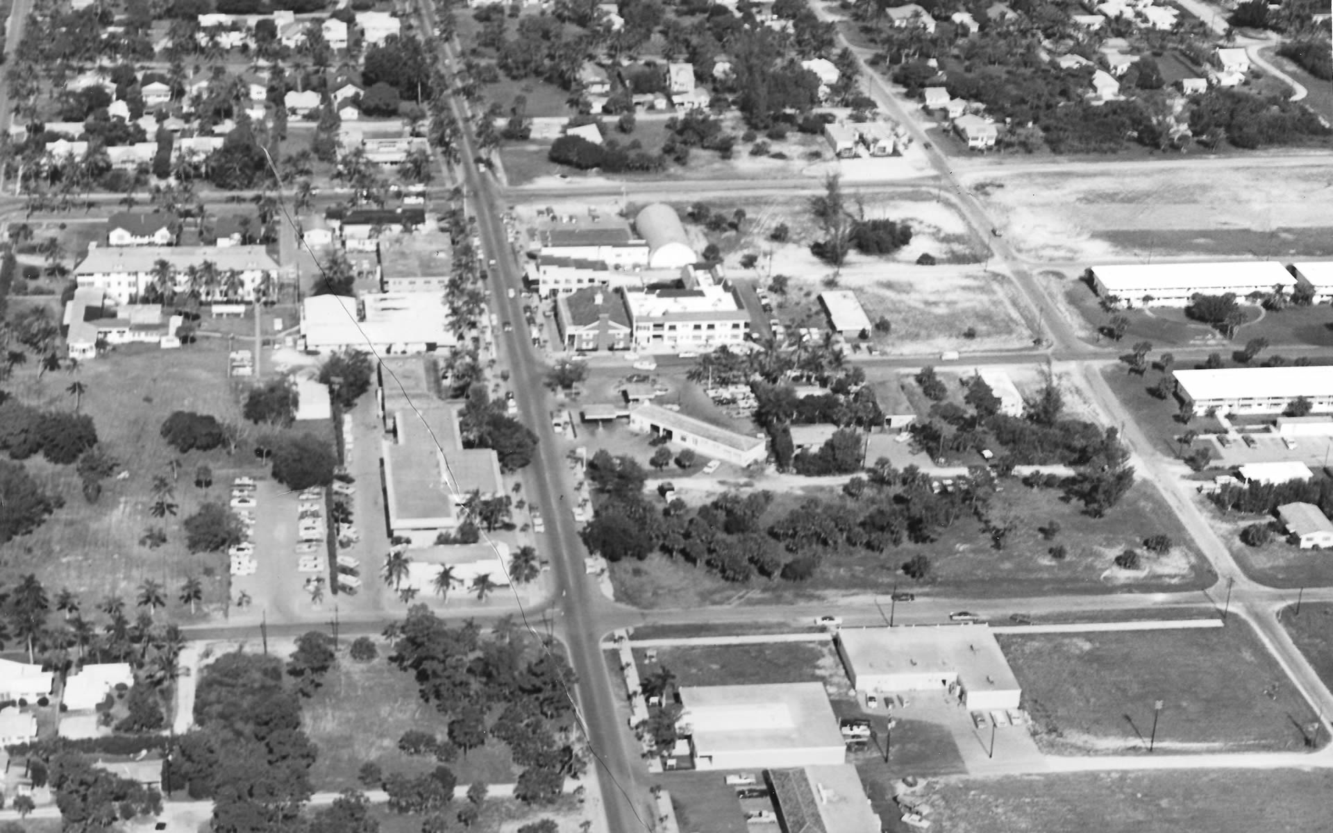 An ariel view of Third Street South in the early 1950's showing The Beach Store and the quonset hut movie theatre (now Marissa's) on the corner of Third and Broad.