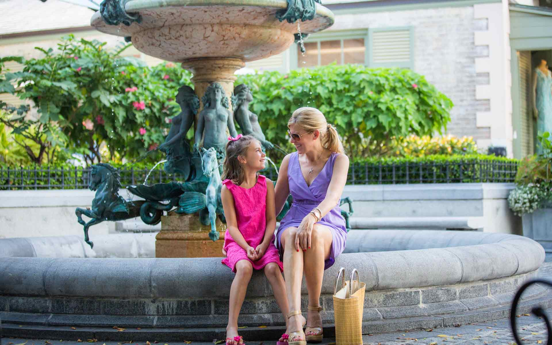 mother and daughter by fountain