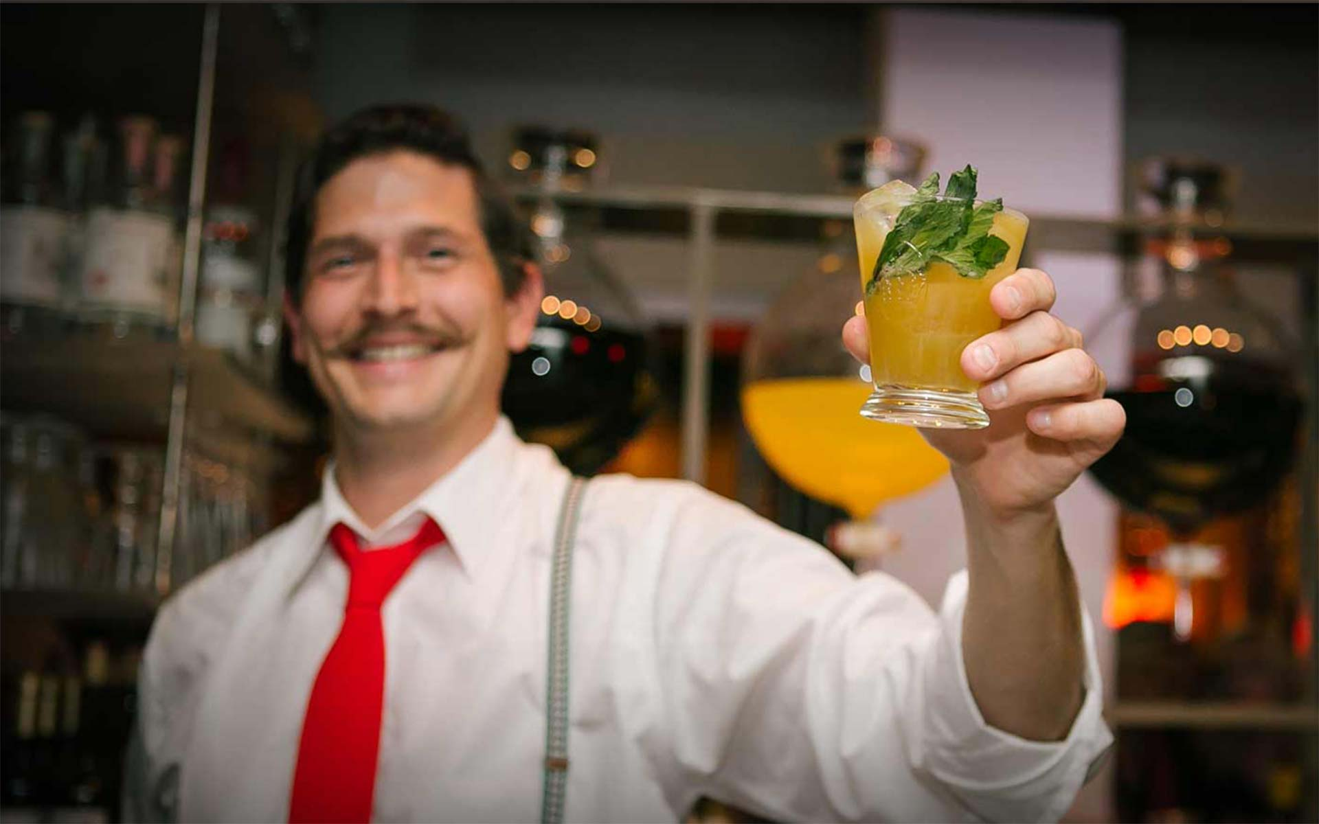 Continental bartender holding a drink